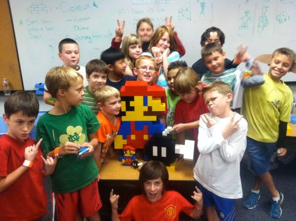 "A past summer camp's Camp Project, a 3 foot tall LEGO 8-bit ""Mario"" and ""Bob-om"" sculpture."